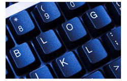 Computer keyboard with the word blog spelled out in the keys