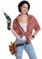 Cute girl wearing tool belt holding a drill