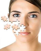 Woman whose face is breaking off into pieces of a puzzle