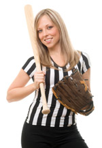 Woman in a referee uniform with a baseball and a bat